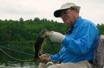 Lefty Kreh admires a chunky little largemouth bass