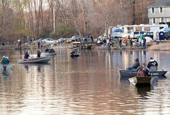 Boats jockey for position as the shore is lined with anglers, trucks, tents and RVs