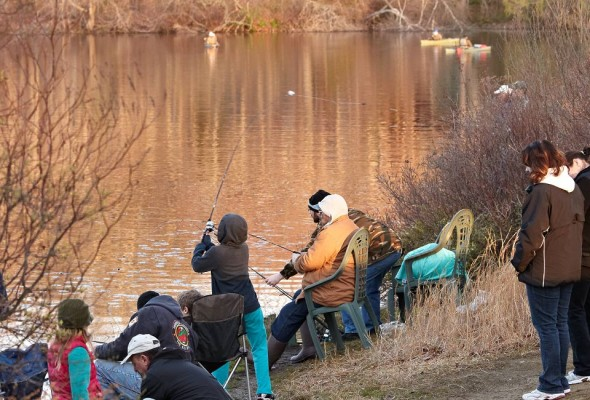 Anglers line up to catch trout