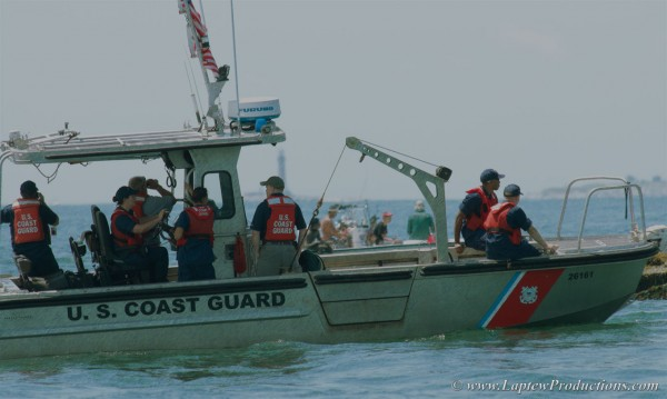Coast Guard crew carefully approaches the lighthouse for a visit.