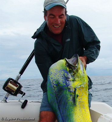 Ron struggles o hoist up a large mahi mahi